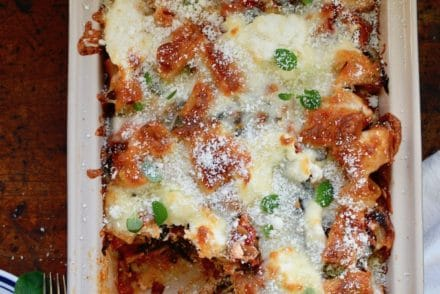 A cozy, vegetarian baked rigatoni that is loaded with six different vegetables and three kinds of cheese in a subtly spicy ancho chile-tomato sauce. So perfect for a cold winter night when you need something comforting but not too heavy and super easy to make in less than an hour! #vegetarian #bakedpasta #vegetarianpasta #vegetariandinner #potluckpasta #freezermeal