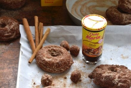 Homemade donuts are an enormous treat and these Mole Membrillo Donuts are extra special made with spiced mole and quince paste, also known as membrillo. The mole paste is decadent in these donuts adding warm spice, chocolate notes, and a hit of chili. These old fashioned cake donuts have a craggy crust, perfect for holding the cinnamon-sugar sprinkle! #donuts #doughnuts #mole #awakenyoursenses #cakedonuts #frieddonuts #oldfashioneddonuts