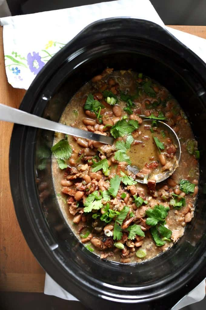 Slow Cooker Borracho Beans in a black pot.