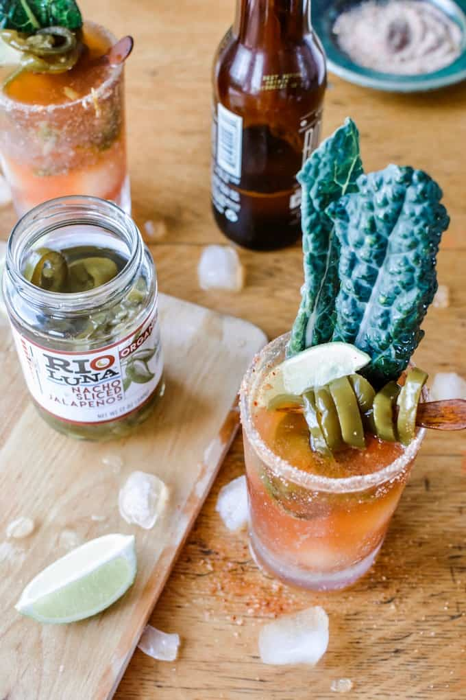 #ad|This is the best Spicy Jalapeño Michelada you will ever try. This authentic Mexican beer cocktail is flavored with tomato juice, fiery pickling liquid from the peppers and a whole pile of jalapeños and lime. #michelada #jalapenos #beercocktail #beer #spicycocktail