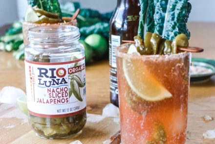 #ad|This is the best Spicy Jalapeño Michelada you will ever try, flavored with fiery pickling liquid from the peppers and a whole pile of jalapeños and lime. #michelada #jalapenos #beercocktail #beer #spicycocktail