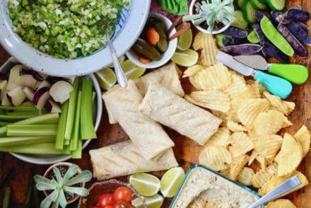 A Mexican Appetizer Board is the ultimate snack board for any party. This one is full of Mexican favorites like taquitos and chimichangas, dips & veggies. #mexicanappetizer #snackboard #partysnacks #mexicanfiesta