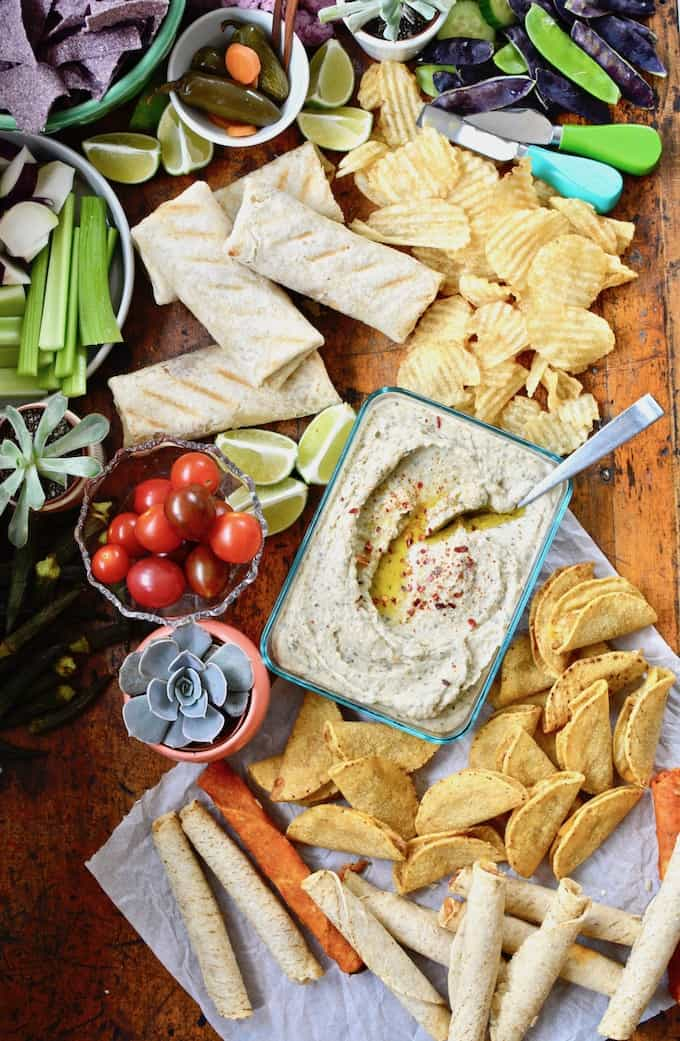 er Board that will up your hostess game. This one is full of Mexican favorites like taquitos and chimichangas, dips & veggies. #mexicanappetizers #snackboard #mexicansnacks #partyfood