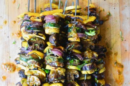 Grilled veggie skewers are the perfect way to celebrate summer produce, especially when drizzled with a smoky green chile vinaigrette! #skewers #vegandinner #grilledvegetables #greenchiles #ad #holajalapeno