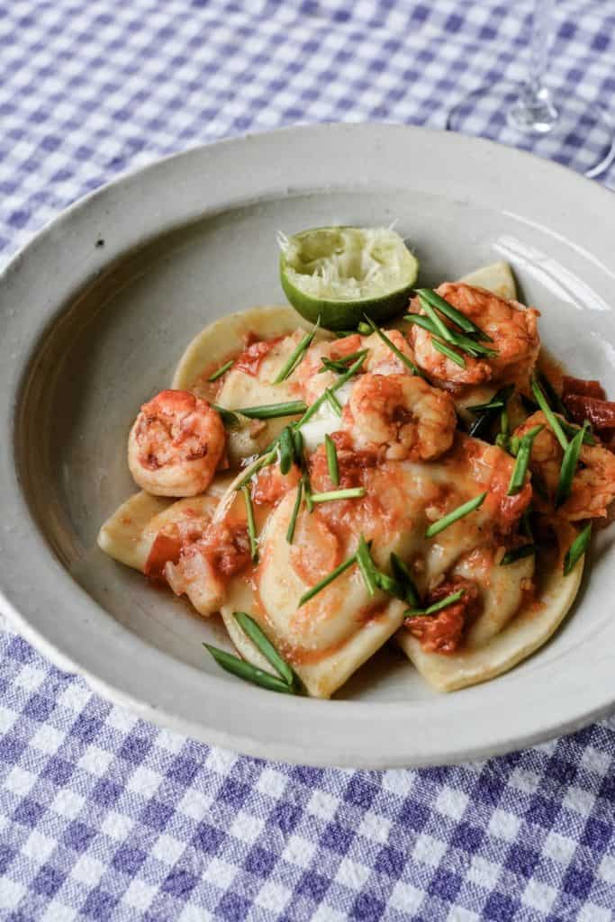 The ultimate recipes for Tequila Lime Shrimp with Pierogies. With a spectacular tequila-tomato sauce with lime, chile, shrimp and Mrs. T's Sour Cream and Chive Pierogies. #ad #MrsTPierogies #holajalapeno #pierogies #shrimprecipe #tequilashrimp
