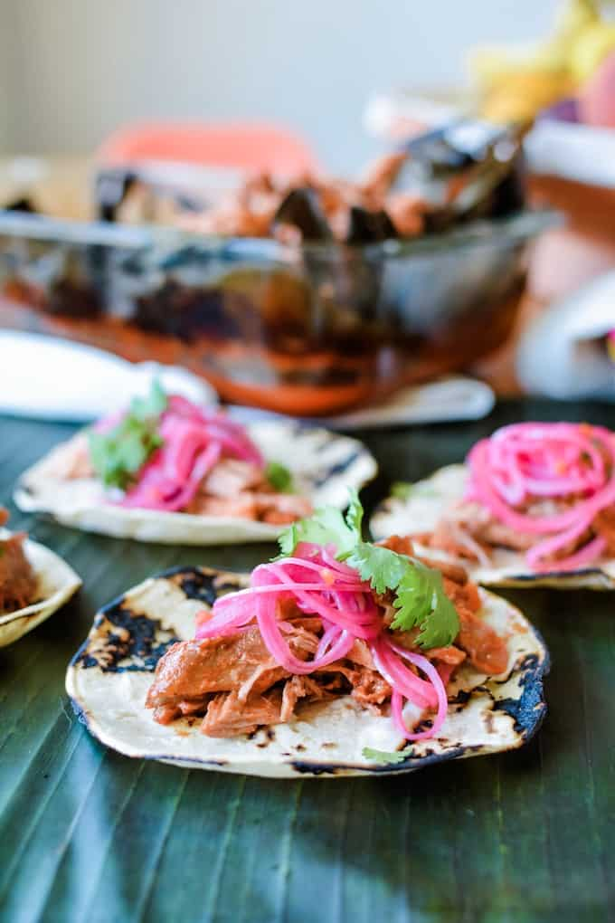 Cochinita Pibil traditionally is cooked low and slow outside, but you can easily recreate the same great flavors by baking it in a deep pan in the oven. #ad #pyrexdeep #holajalapeno #cochinitapibil #dayofthedeadrecipe #PyrexAmbassador