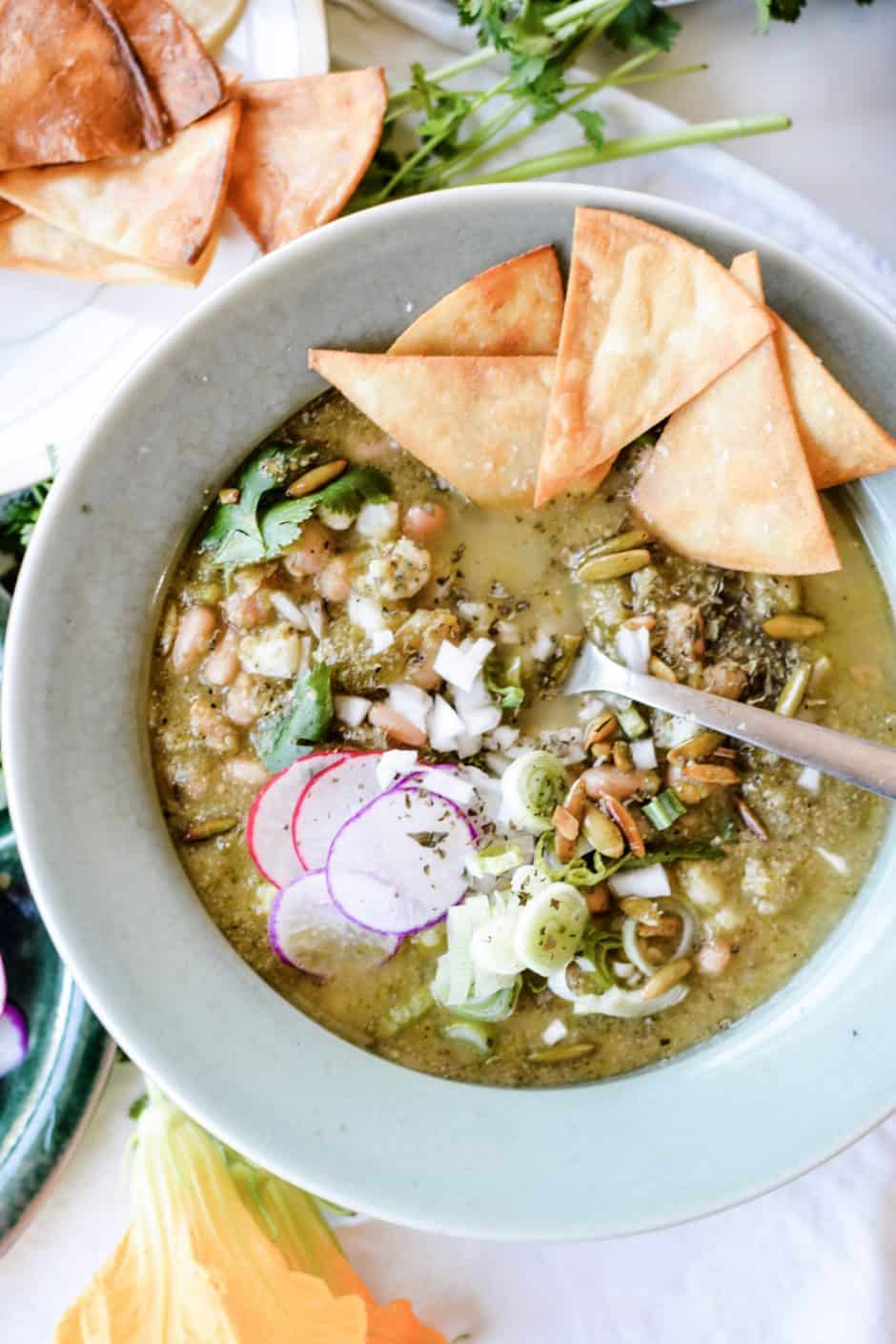 A spicy Pozole Verde that just so happens to be vegan. Made with green chiles, jalapeños, pinto beans and hominy. One of my favorite Mexican dinner ideas! #sponsored #holajalapeno #pozole #vegan