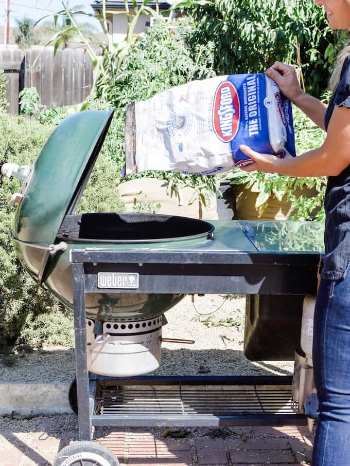 Filling the grill with Kingsford Charcoal for the best authentic BBQ flavor.