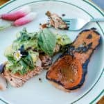 Smoky wood-fired grilled salmon marinated in chipotle, ancho chile, and garlic then topped with homemade guacamole mixed with tons of fresh herbs and lime. #ad #holajalapeno #kingsfordcharcoal #grilledsalmon