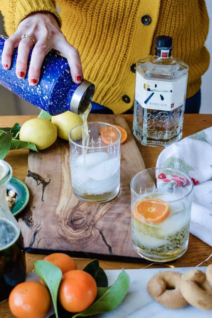 This pale green cocktail is the perfect drink to serve this year for las posadas. #ad #roku #holajalapeno #laposada