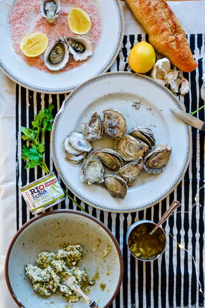 Lining a plate with kosher salt keeps the oysters from tipping over. Check out this post on how to BBQ oysters for New Year's Eve! #ad #holajalapeno #bbqoysters #riolunaorganic