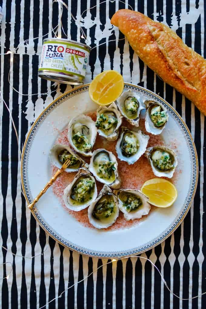 Elevate your New Year's Eve appetizer game with these ultra fancy BBQ Oysters bathed in a spicy Green Chile Garlic Butter. #ad #bbqoysters #holajalapeno #riolunaorganic