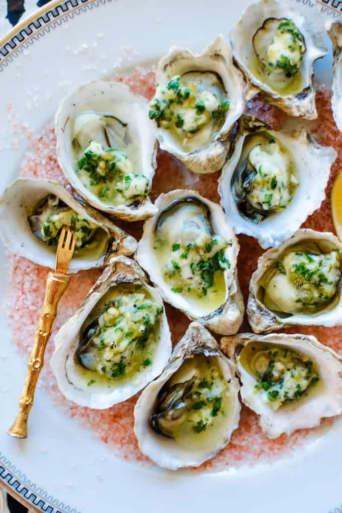 #ad | BBQ Oysters are the way to go this New Year's Eve. Especially when they are topped with Rio Luna Organics Green Chile and Garlic butter. #holajalapeno #riolunaorganic #greenchiles #oysters