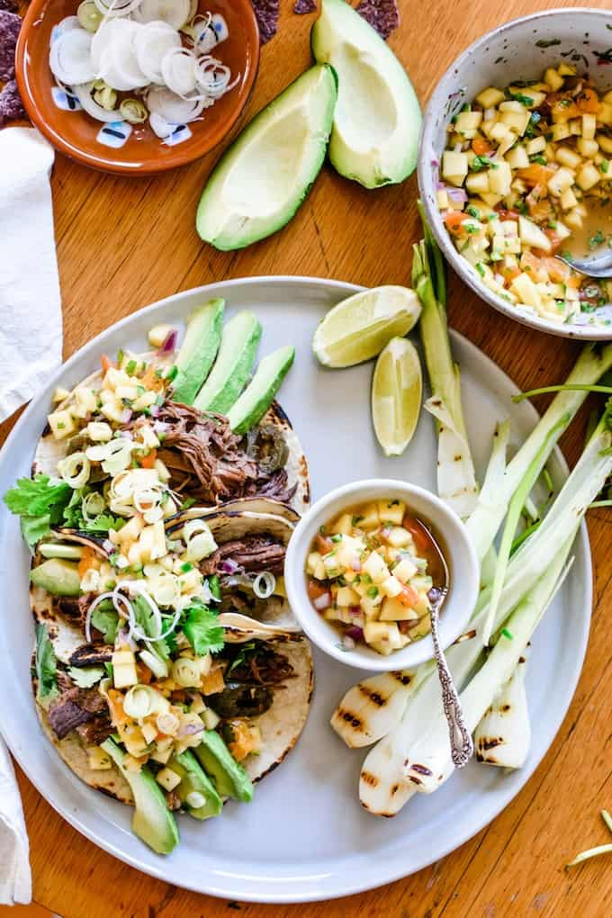 For this take on Mexican shredded beef tacos we loaded up on the sliced jalapeños and let it cook low and slow in the slow cooker. Click now for the recipe! #beeftacos #slowcooker #tacorecipe #slowcookerrecipe #ad #mexicanfoodrecipe