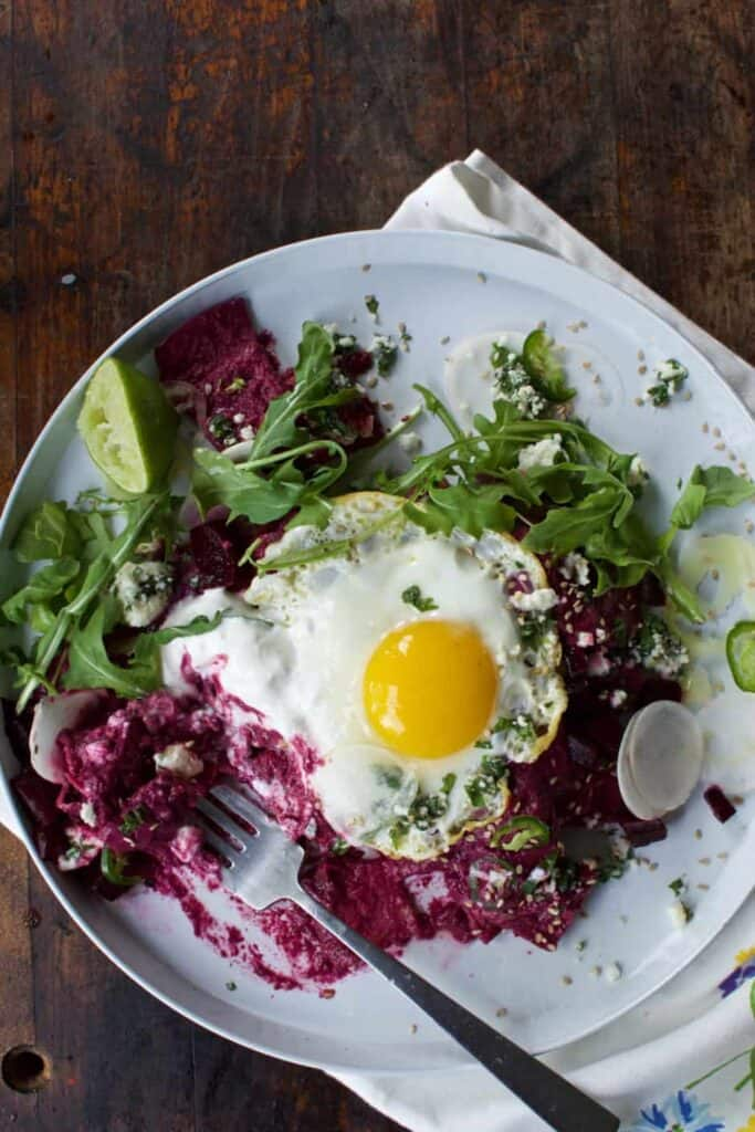 Mexican dinner ideas like these beet chilaquiles are a surprising recipe you can make straight from your fridge and pantry with ingredients you already have. Pin here for 13 delicious ideas!