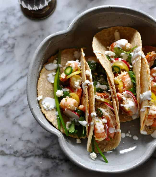 Mexican tacos like this Salt and Pepper Shrimp Tacos recipe can be made simply with ingredients already in your pantry, fridge, and freezer. Pin now to save all 13 pantry recipe ideas.