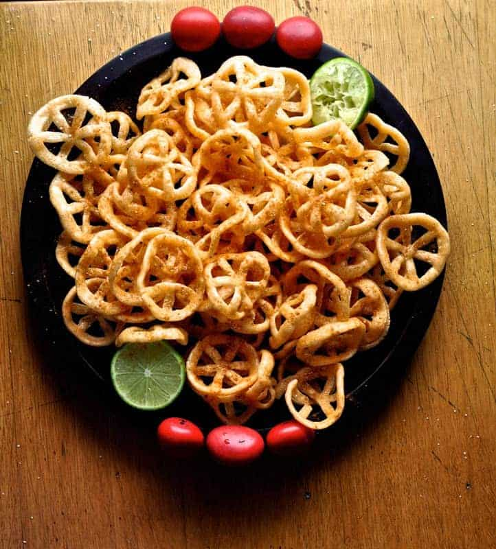 Homemade chicharrones de harina or Mexican fried wheat crisps are the ultimate crunchy street food snack. These crispy wheels are totally addictive doused with lime and hot sauce and are one of our most popular Mexican appetizers. #mexicandishes #chicharronesdeharina #duros #Mexicanchips #cincodemayo