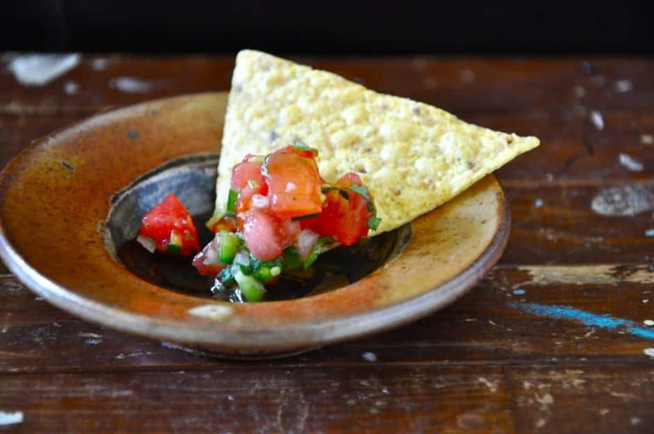 The classic Mexican salsa recipe, Pico de Gallo is easy to make and has all the fresh, bright flavors that bring joy to your everything from tacos to chips! This is one of the most essential Cinco de Mayo recipes for sure. Get the full Stay Inside Cinco de Mayo Party Guide now! #Mexicanpartymenu #mexicanfood #picodegallo #mexicansalsa