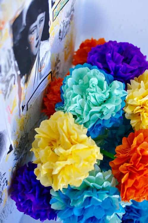 Learn how to make fun tissue paper flower decorations for Cinco de Mayo. #cincodemayoparty #cincodemayo #paperflowers #tissuepaperflowers