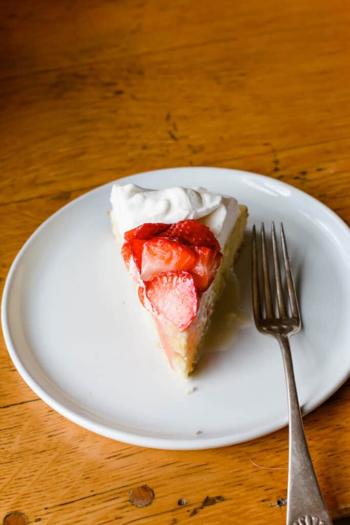 A slice of three of my favorite desserts rolled into one: Meyer lemon Tres Leches Strawberry Shortcake. Perfect for Cinco de Mayo, Mother's Day, or Spring Birthdays. #strawberry #strawberryshortcake #meyerlemon #tresleches