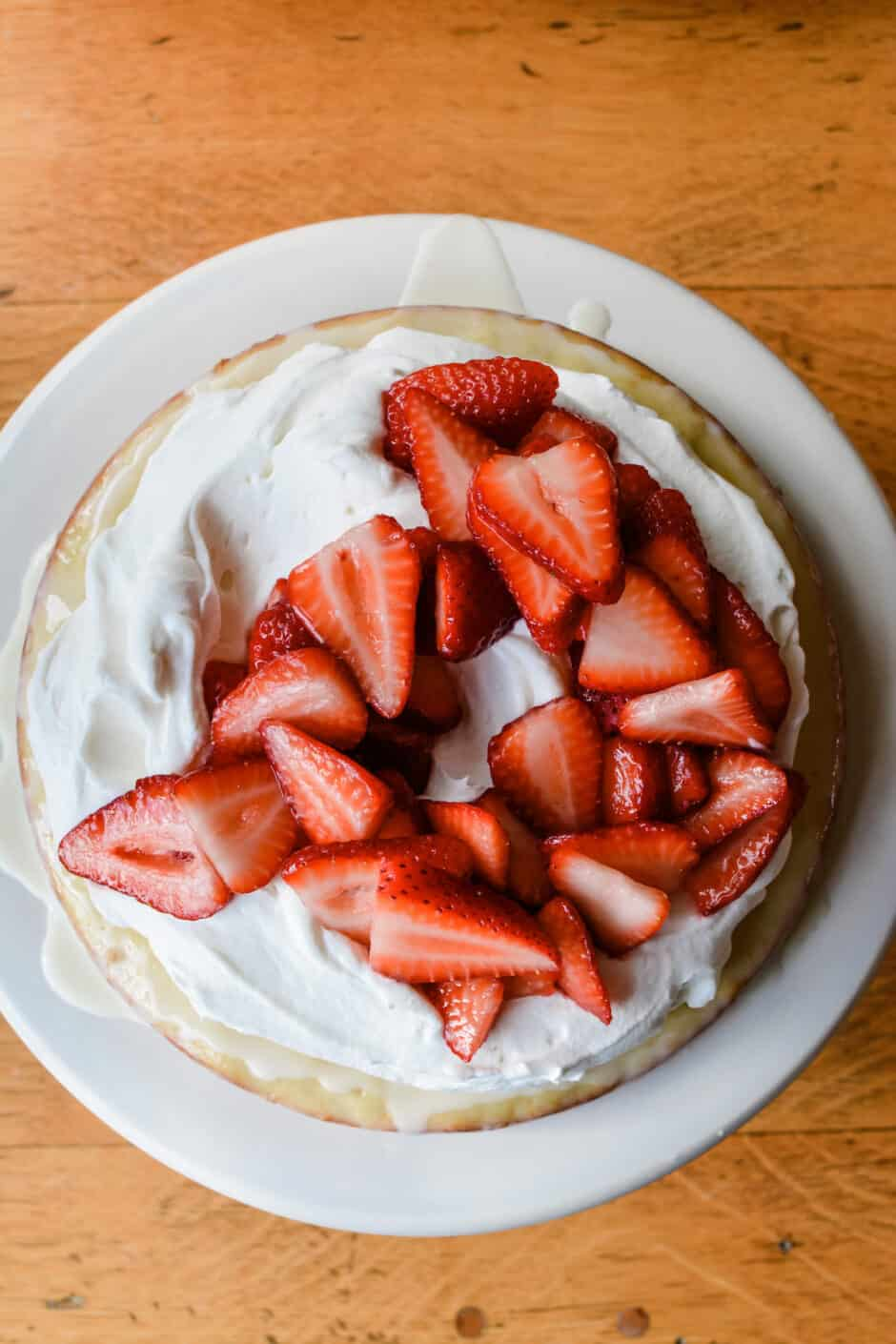 How to make a whole new take on strawberry shortcake! A Meyer lemon butter cake soaked in the classic tres leches cream and topped with juicy strawberries. #strawberryshortcake #meyerlemon #treslechescake #strawberryshortcakerecipe