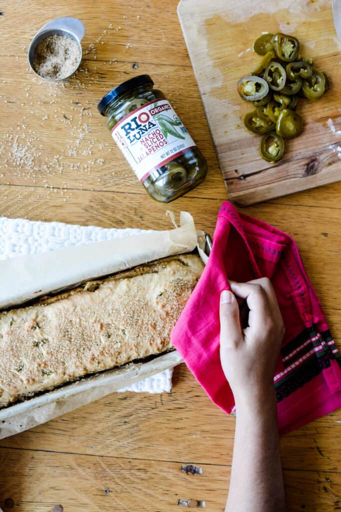 The super simple bread recipe you've been waiting for! No yeast, no eggs, this Jalapeño Beer Bread is made for our quarantine pantries. Great sandwich bread, toast, or to dip into stew! #beerbread #easybreadrecipe #homemadebread #noyeastbread