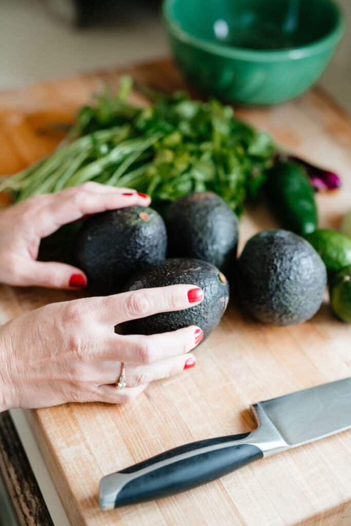 Avocados are essential to the Mexican pantry and native to the country. Find out what else you need to make the ultimate Mexican pantry in your home. #mexicanfood #mexicanrecipes #mexicanpantry #avocados