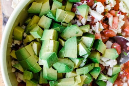 A very good vegan ceviche recipe with creamy avocado, small bites of cauliflower, chile, tomato, and cucumber soaked in loads of lime and toasted cumin seeds. #veganceviche #ceviche #vegan #avocado