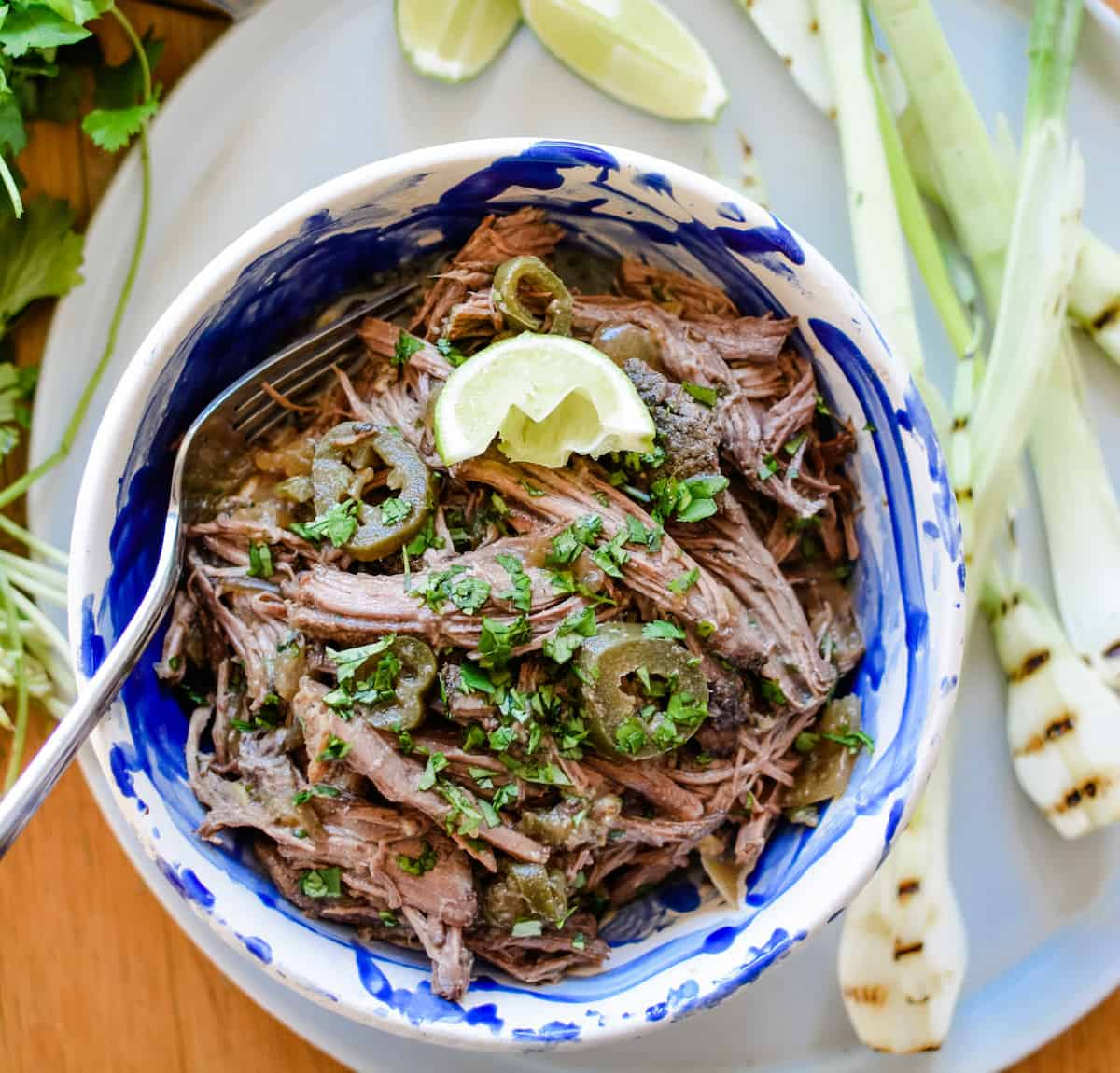 Mexican Shredded Beef for tacos, gorditas, tostadas, and more! With stove top, slow cooker, and Instant Pot instructions included. #shreddedbeef #beeffortacos #Mexicanshreddedbeef #beeftacos