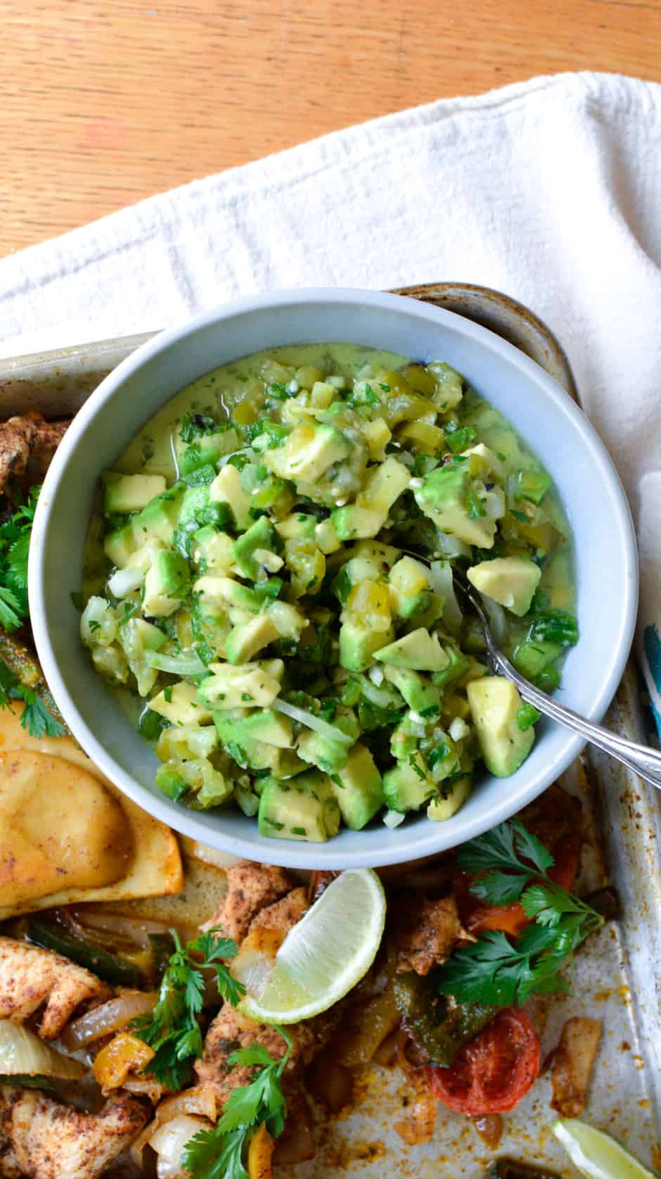 If you've been hunting for an easy Avocado Salsa recipe, look no further! Ripe avocado, fresh cilantro, and lots of spicy jalapeños make this completely irresistible. This avocado salsa is as perfect on a tortilla chip as it is over a piece of grilled salmon. #avocadosalsa #avocados #avocadosalsarecipe #avocadorecipe