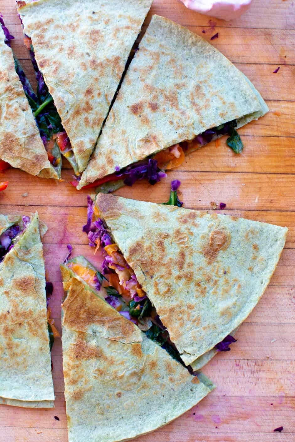 This super yummy Rainbow Veggie Quesadilla filled with a boatload of colorful vegetables and lots of melted cheese. A quick and easy recipe that is a clear winner for the whole family. Keep these veggies in the fridge for a healthy meal any time hunger strikes! #quesadilla #quesadillarecipe #mexicanquesadillas #veggiequesadilla #ad