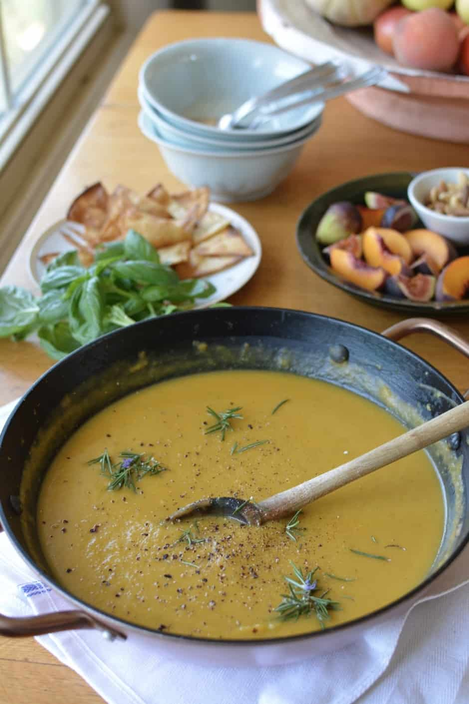 Homemade Roasted Squash Soup with just 10 ingredients! This soup recipe is healthy and has a deliciously creamy flavor with coconut milk, ground coriander, and guajillo chili powder. A super easy vegan and naturally gluten-free comfort food recipe! #roastedsquashsoup #butternutsquashsoup #vegansoup #easysoup