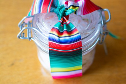 How to make your own Tequila Flavored Salt, using two simple ingredients and no special equipment. This delicious salt makes a lovely homemade gift and can be used on everything from rimming a margarita glass to seasoning French fries. #flavoredsalt #ediblegift #homemadegift #christmas #tequila