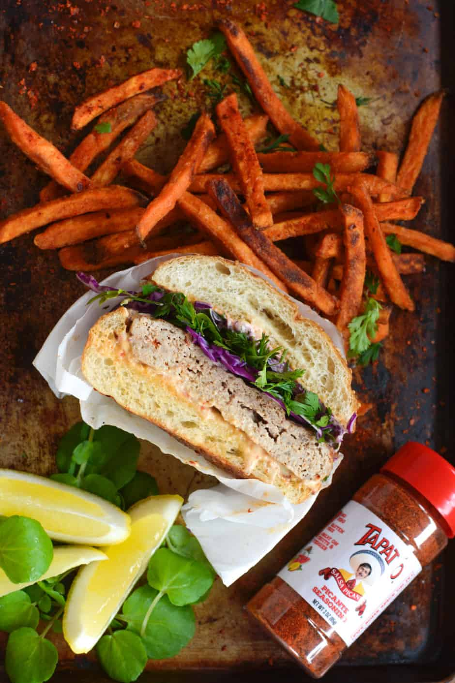 The BEST Turkey Burger recipe! This one is anything but boring, seasoned with Tapatio hot sauce, a simple spice blend, and Worcestershire with a little spicy mayo on top to boot. Serve the turkey burger with sweet potato fries and a simple Cilantro-Lime Slaw for an easy, healthy, and delicious dinner. #turkeyburgerrecipe #turkeyburger #spicyturkeyburger #tapatio