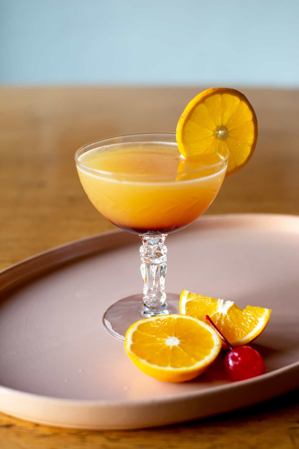 How to make a Tequila Sunrise cocktail with homemade grenadine using a simple combination of pomegranate juice, sugar, and orange peel. This simple cocktail makes a great brunch drink or easy-going sipper with tequila, orange juice and grenadine. #tequilasunrise #tequila #tequilacocktail #cagrown #ad