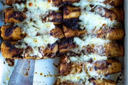 Vegetarian Enchiladas with sautéed shiitake mushrooms and a blend of creamy Oaxaca cheese and sharp Gruyere. Top with guacamole and Mexican crema for an easy, healthy Cinco de Mayo recipe! This year celebrate en su casa with the most perfect vegetarian enchilada recipe. #ad #vegetarianenchiladas #enchiladas #enchiladarecipe #latortillafactory