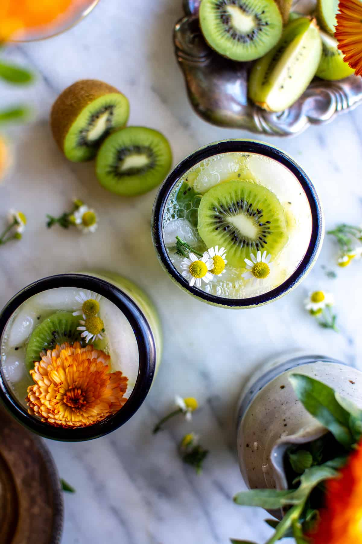 This Kiwi Caipirinha Cocktail is made with ripe, juicy California kiwifruit and limes, honey and cachaça—Brazil's most popular sugarcane liquor. Delicious and refreshing- perfect for summer! #ad #cagrown #caipirinha #kiwi