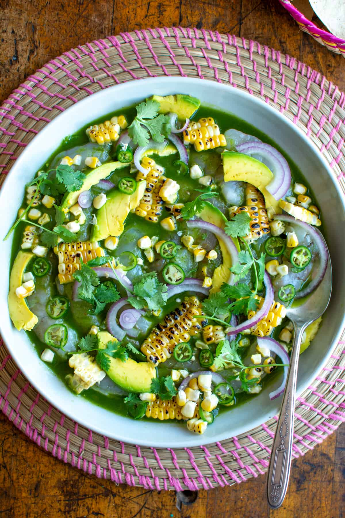 How to make Shrimp Aguachile Verde, one of Mexico's most delicious seafood dishes. This no-cook appetizer takes raw shrimp and marinates them in a spicy mixture of serrano peppers, lime juice, and cucumber. Serve with tostadas for a refreshing summertime recipe. #holajalapeno #aguachile #shrimp #nocook