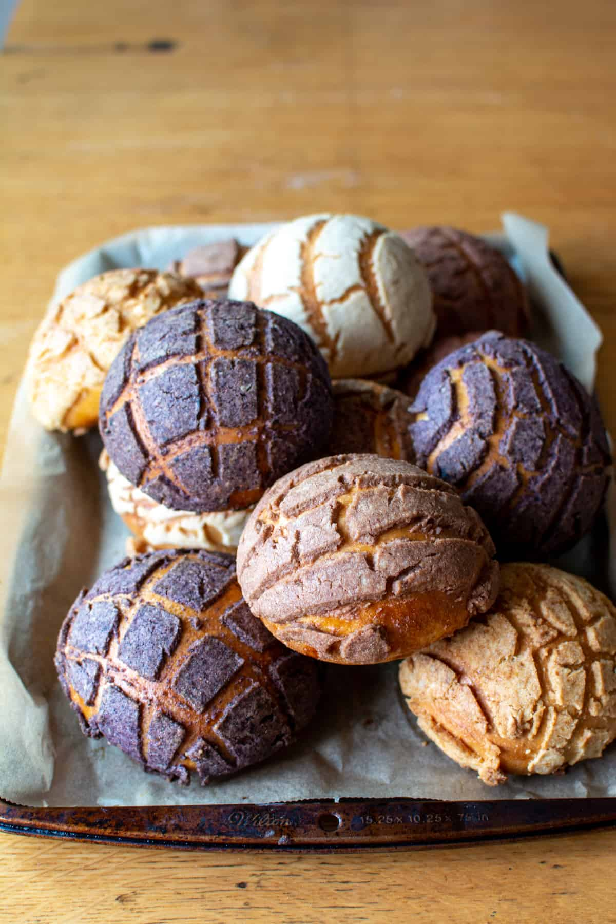 This dairy-free Concha recipe will take you step-by-step through how to make this soft and pillowy Mexican sweet bread at home. They taste exactly like the lightly sweetened bread roll with the crunchy topping you find at your local Mexican bakery—but dairy-free! #holajalapeno #concha #vegan